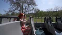 young pretty women enjoying an open top bus - stock footage