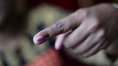 Mid close shot of first time Indian voter showing voting right  - stock footage