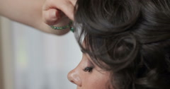 Beautiful brunette bride preparing for marriage, doing hairstyle Stock Footage