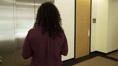 Businesswoman getting on an elevator and the doors close 4k Stock Footage