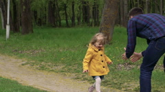 Little three years old girl running to father, turning around. Slowly Stock Footage