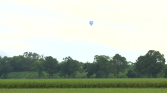 Hot air balloon flying in the cloudy sky and hot air balloon stopped Stock Footage