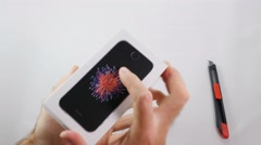 Man unboxing iPhone SE Stock Footage