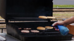 Setting Fire to the Grill for Frying Raw Meat and buns for Burgers - stock footage