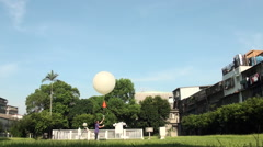 A person launching a radiosonde balloon air Stock Footage