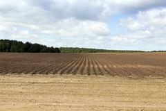 Plowed land, furrows Stock Photos
