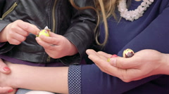 Mother and daughter opening chocolate Easter eggs. Slowly Stock Footage