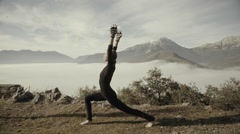 Woman exercising yoga in Greek nature,mountain,village,winter time,morning - stock footage