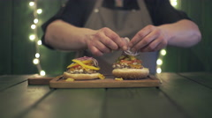 Chef makes burger set Stock Footage