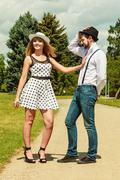 Loving couple retro style flirting in park Stock Photos