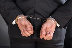 Close-up Of Businessman In Handcuffs Arrested For Crime - stock photo