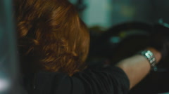 Red hair woman sit inside the car while another woman frightened her gazing - stock footage