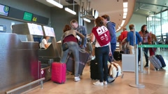 Airline passengers checking in at the Valencia Airport. - stock footage