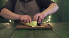 Chef makes salad with warm salmon Stock Footage