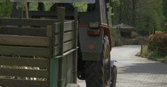 Mini Tractor Transporting Hay at the Zoo Stock Footage