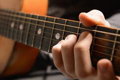 Musical instrument with performer hands - stock photo