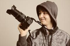 Paparazzi man taking picture with photo  DSLR digital camera - stock photo