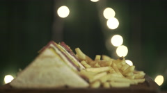 Sandwiches set rotate on a board. Close up Stock Footage