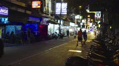 People walk in night asian street in Pattaya - stock footage