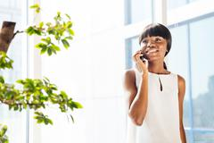 Afro american woman talking on the phone in office Stock Photos