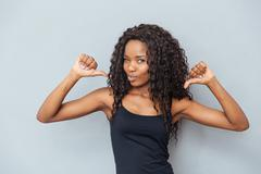 Afro american woman showing fingers at herself Stock Photos