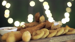 Nuggets set rotate on a board. Close up Stock Footage