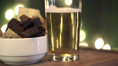 Gold beer with a snacks rotate on a board Stock Footage