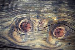 beautiful wood knots on fir plank, real interesting texture of weathered wood - stock photo