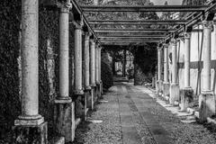 Colonnade leading to the tomb of Juliet. - stock photo