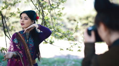 Asian young woman posing to photographer Stock Footage