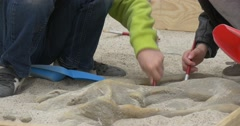 Boys Playing in Archaeologists in Kindergarten Stock Footage