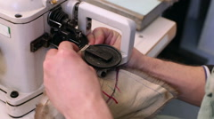 Production of clothes from fur. Male hand sew fur on furrier machine. Stock Footage
