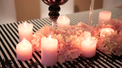 Decorated table with candles and decorations. beautiful vases Stock Footage