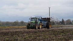 Muck spreading machine working in field yorkshire united kingdom Stock Footage