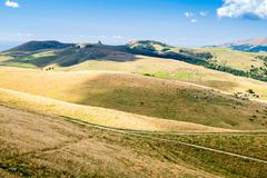 Meadows in the mountains create sinuous lines. - stock photo