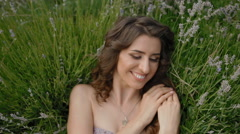 Young woman pose to photographer in lavender Stock Footage