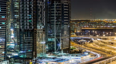 Buildings of Jumeirah Lakes Towers with traffic on the road night timelapse Stock Footage