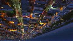 Upside down night aerial tour Miami Beach - stock footage