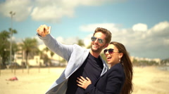 Happy young couple taking selfie on beachfront Stock Footage