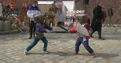 Two Children Take Part in a Cheerful Duel Stock Footage