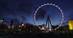 The illuminated High Roller Ferris Wheel in full LED illumination in Time Lapse Stock Footage