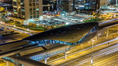 Metro station near Buildings of Jumeirah Lakes Towers with traffic on the road Stock Footage