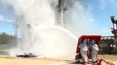 Firefighters extinguish an oil storage - stock footage