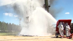 Firefighters extinguish a fire at an oil storage - stock footage