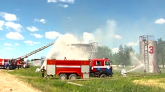 Firefighters extinguish a fire at an oil storage Stock Footage