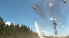 large helicopter extinguishes  wildfire - stock footage