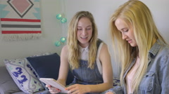 Girl Studies With A Tablet, Her Friend Joins Her, Organizes Her Notes Stock Footage