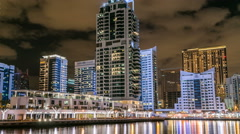 View of Dubai Marina Towers and canal in Dubai night timelapse Stock Footage