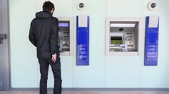 Man Using ATM Bank Machine Outdoors Stock Footage