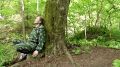 Girl shoots gun out of hiding. Woman shoots in the forest. shooting training. Stock Footage